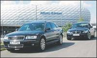 Two limousines in front of the allianz arena in munich.