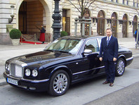 A chauffeur in front of the Adlon in berlin.
